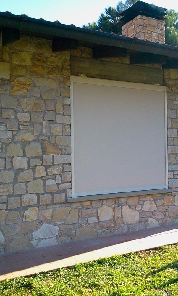 Tenda da sole a caduta con guide per finestre